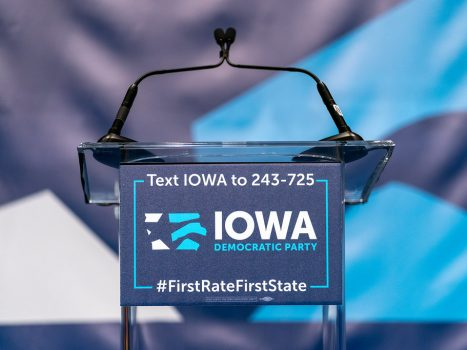 """Microphone and Iowa Democratic Party Podium"" by Lorie Shaull is licensed under CC BY-SA 2.0"
